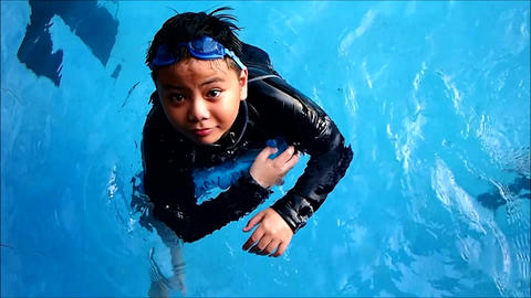 Young boy in a swimming pool Footage