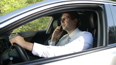 Successful man in car talking on cell phone Footage