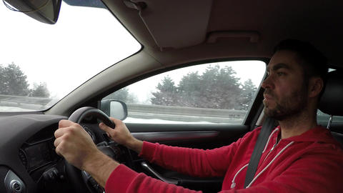 Driving a car in winter Filmmaterial