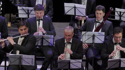 Orchestra. Musicians play on wind instruments Footage