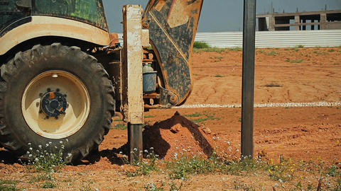 Cinemagraph of tractor with a drilling device at a construction site 画像
