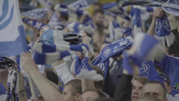 The fans' hands rotate the scarves of fans. Slow Motion Footage