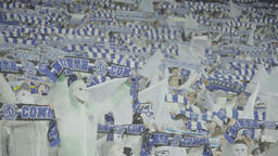 Fans during the match keep scarves over their heads Footage