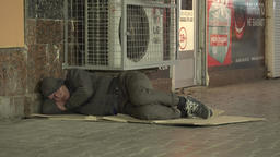 Poverty. A homeless man sleeping on the floor Footage