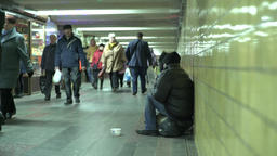 Tramp. Poor begs for alms in the underground passage Footage