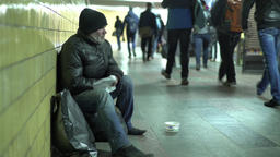 Poverty. The beggar asks alms. Tramp. Homeless Footage