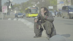 Poverty. Beggar homeless man on the city street Footage