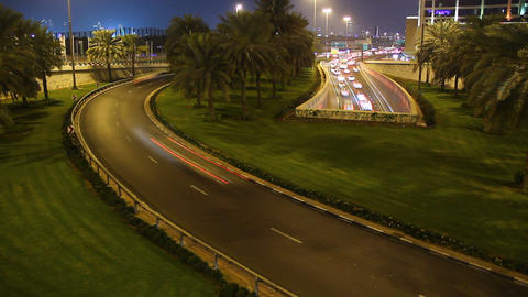Multiple roads fast traffic flow in night, bend road, underpass exit, time lapse Footage