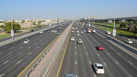 Sparse daytime traffic, cars run along widest Sheikh Zayed highway Footage