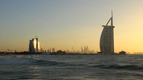 Sunset beach view, Jumeirah Beach Hotel and Burj Al Arab at evening light Footage