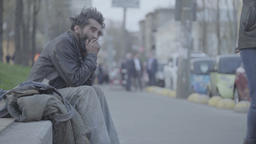 Crisis and poverty. The homeless beggar sits on the street Footage