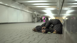 Beggar homeless in the underpass Footage