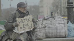 "A homeless man on the street with a cardboard ""Work for food"" Footage"