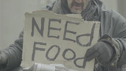 "Cardboard with the inscription ""Need food"" Footage"