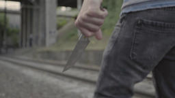 A man is a murderer with a knife. Close-up Footage