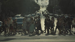 Landscape of the big city. People cross the street on a pedestrian crossing Footage