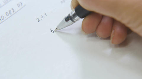 Macro Woman Writes Data with Black Pen on Sheet in Study Footage