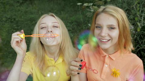Girls blowing bubbles Archivo