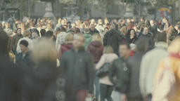 Crowd. Many people walk down the street of the city. Slow Motion Footage