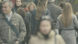 Many people walk down the street. Crowded street. Crowd of people Footage