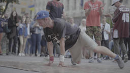 Street dancer. The guy is dancing breakdance on the city street. Slow motion Live Action