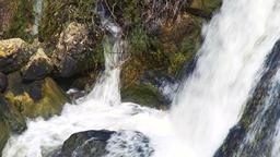 Water-falling-over-and-on-rocks GJEdUPfu Archivo