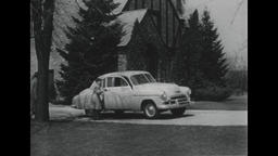 USA 1950s: Family Enters Chevrolet Car in Front of Large Home Estate Footage