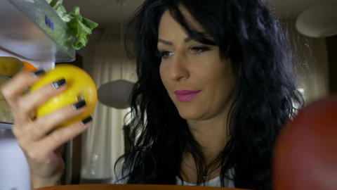 Closeup of raw vegan woman having a healthy lifestyle opening refrigerator and c Footage