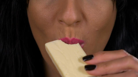 Closeup of sensual female lips tasting white chocolate Footage