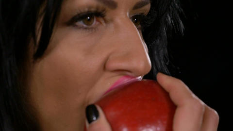 Slow motion of seductive woman biting a tasty red apple Live Action