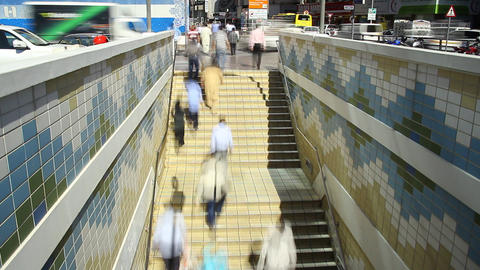 People rush up and down, underground passage entrance staircase, time lapse Footage