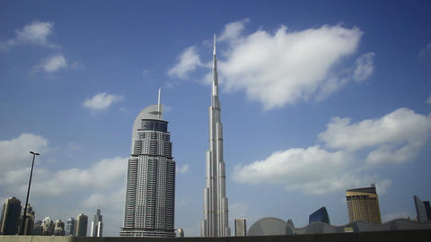 Soft clouds fly over Burj Khalifa and Address Downtown hotel, time lapse Footage