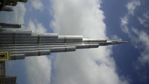 Burj Khalifa Supertall Skyscraper Against Blue Sky And Fast Clouds, Time Lapse stock footage
