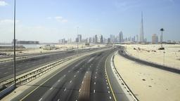 Wide highway at deserted area, modern Dubai Downtown skyline on horizon Footage
