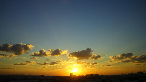 Vibrant unusual colors of sunset, sky with cumulus clouds against sun light Footage