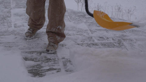 View of a man shoveling snow Footage