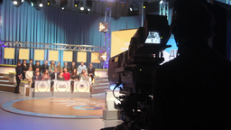 The cameraman shoots in the TV Studio Footage