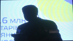 The silhouette of the presenter in the TV Studio Footage