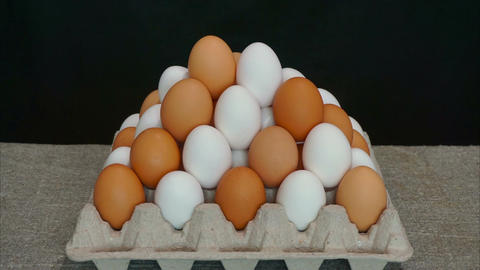 White eggs and brown eggs. Stop motion animation Live Action
