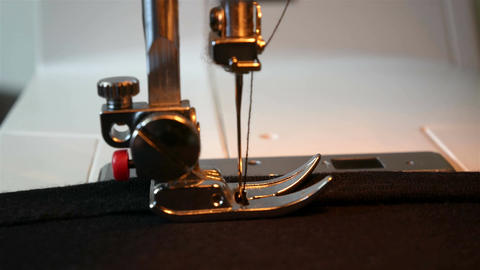 Sewing machine working part with dark cloth Filmmaterial
