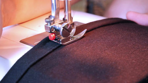 Sewing machine working part with dark cloth Live Action