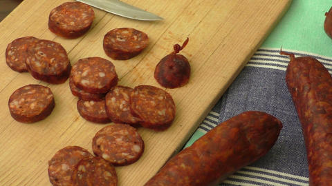 Traditional homemade sausage on the wooden cutting board Live Action