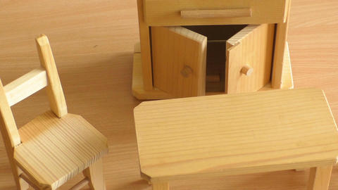 Wooden doll furniture: table, chairs and buffet. Miniature wooden toy furniture  Image