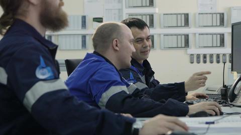 Side View Men in Uniform Sit Look at Modern Monitors on Duty Footage