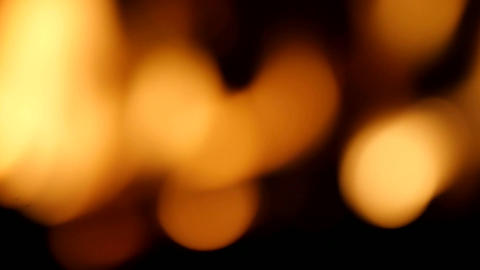 Intense of flames blazing in fireplace, abstract view out of depth of field Footage