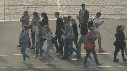 People cross the road on a pedestrian crossing. Slow Motion Footage