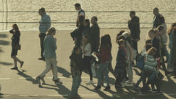 People cross the street on a pedestrian crossing. Slow motion Footage