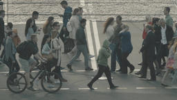 Crowd. People cross the street on a pedestrian crossing. Slow motion Footage