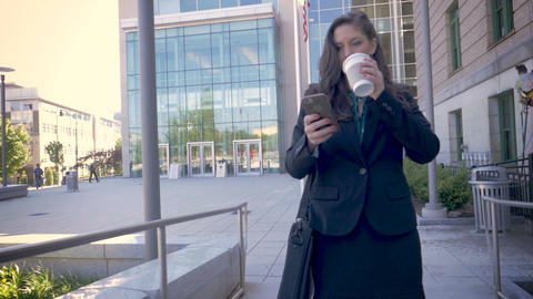 A successful millennial businesswoman executive walking away from a modern Footage