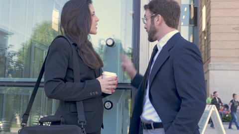 Two attractive millennial ambitious businesspeople shaking hands outside a Footage